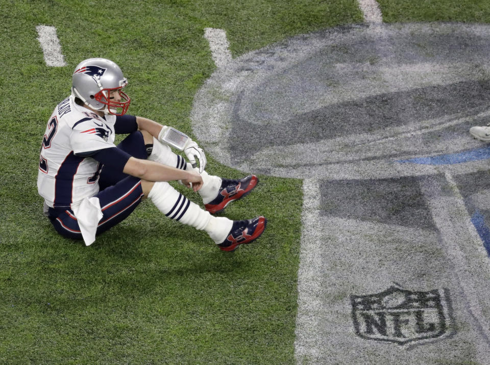 FILE - In this Feb. 4, 2018, file photo, New England Patriots quarterback Tom Brady sits on the field after fumbling against the Philadelphia Eagles during the second half of the NFL Super Bowl 52 football game, in Minneapolis. The Eagles upset the Patriots 41-33. (AP Photo/Eric Gay, File)