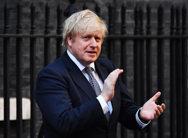 Prime Minister Boris Johnson applauds for key workers outside 10 Downing Street on May 14, 2020 in London, England. (Photo by Leon Neal/Getty Images)