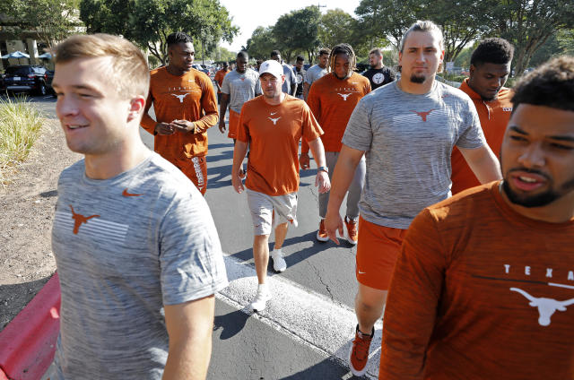 Texas Longhorns head coach Tom Herman (center) walks players around the team hotel Saturday Sept. 7, 2019 Austin, Tx. ( Photo by Edward A. Ornelas )