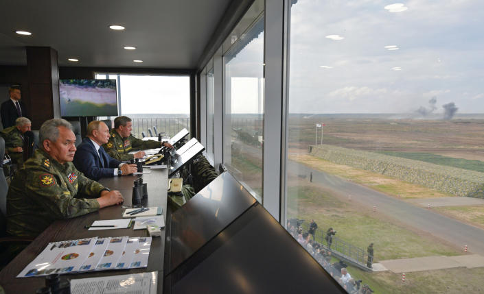 Russian President Vladimir Putin, center, Russian Defense Minister Sergei Shoigu, left, and Russian General Staff Valery Gerasimov, right, watch the joint strategic exercise of the armed forces of the Russian Federation and the Republic of Belarus Zapad-2021 at the Mulino training ground in the Nizhny Novgorod region, Russia, Monday, Sept. 13, 2021. The military drills attend by servicemen of military units and divisions of the Western Military District, representatives of the leadership headquarters and personnel of military contingents of the armed forces of Armenia, Belarus, India, Kazakhstan, Kyrgyzstan and Mongolia. (Alexei Druzhinin, Sputnik, Kremlin Pool Photo via AP)