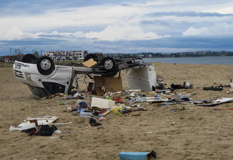 An overturned vehicle is seen on a beach at Sozopoli village in Halkidiki region, northern Greece, Thursday, July 11, 2019. A powerful storm hit northern Greece late Wednesday. (Giannis Moisiadis/InTime News via AP)