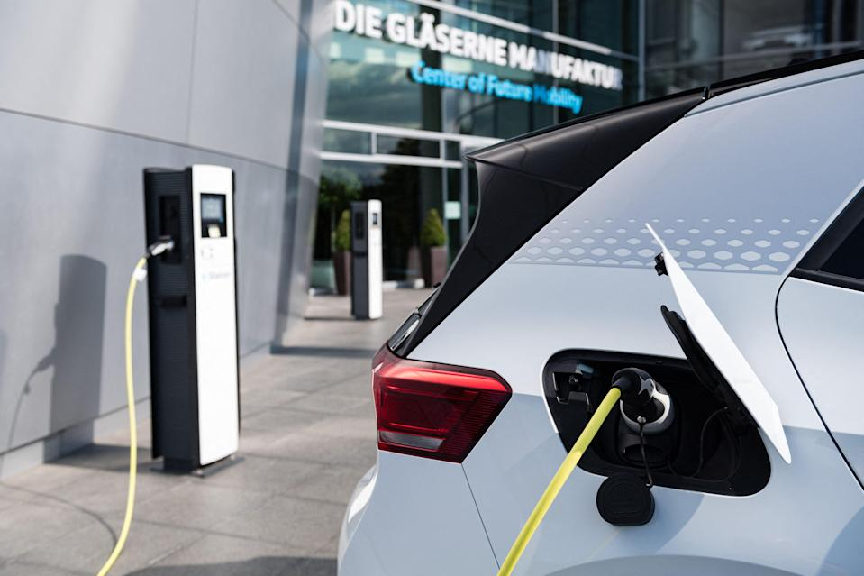 <p>Large-scale deployment of low-carbon technologies such as electric cars, wind turbines and solar panels will be key for tackling the climate crisis</p> (AFP via Getty Images)