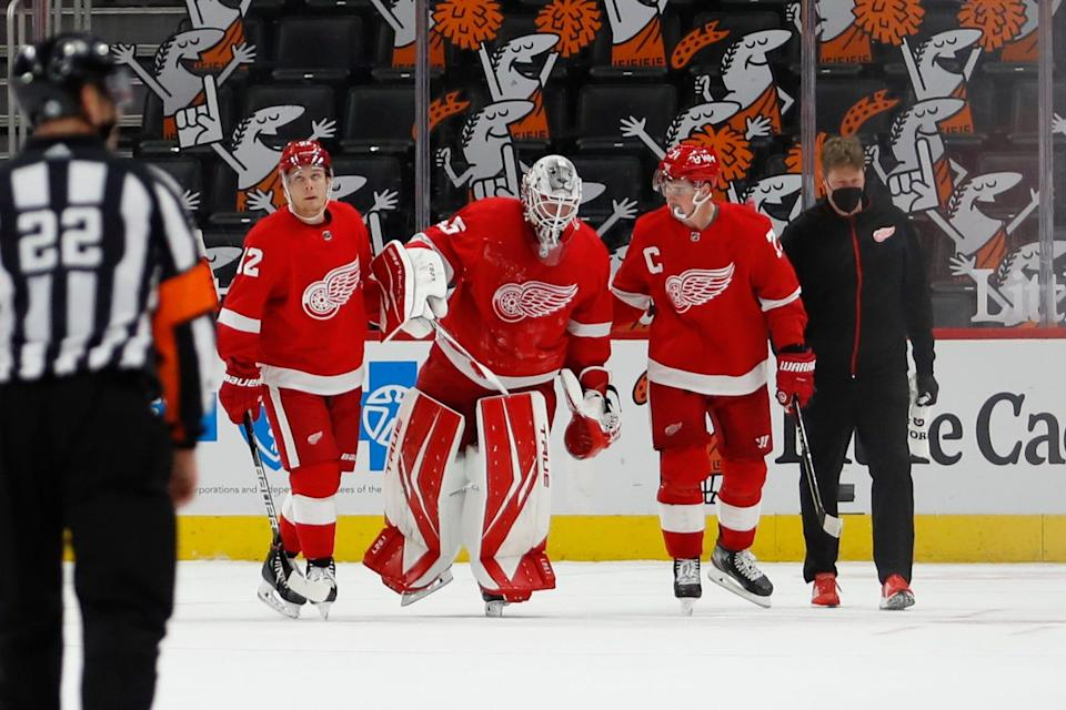 Red Wings center Vladislav Namestnikov, left, and center Dylan Larkin help goaltender Jonathan Bernier off the ice after an injury during the second period of the 3-2 win over the Stars on Thursday, March 18, 2012, at Little Caesars Arena.
