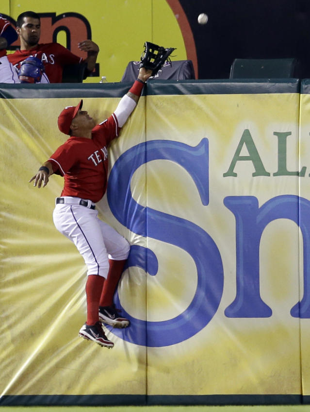 Texas Rangers' Leonys Martin is unable to reach a two-run home run ball by Tampa Bay Rays' Evan Longoria during the third inning of an American League wild-card tiebreaker baseball game Monday, Sept. 30, 2013, in Arlington, Texas. (AP Photo/Tony Gutierrez)