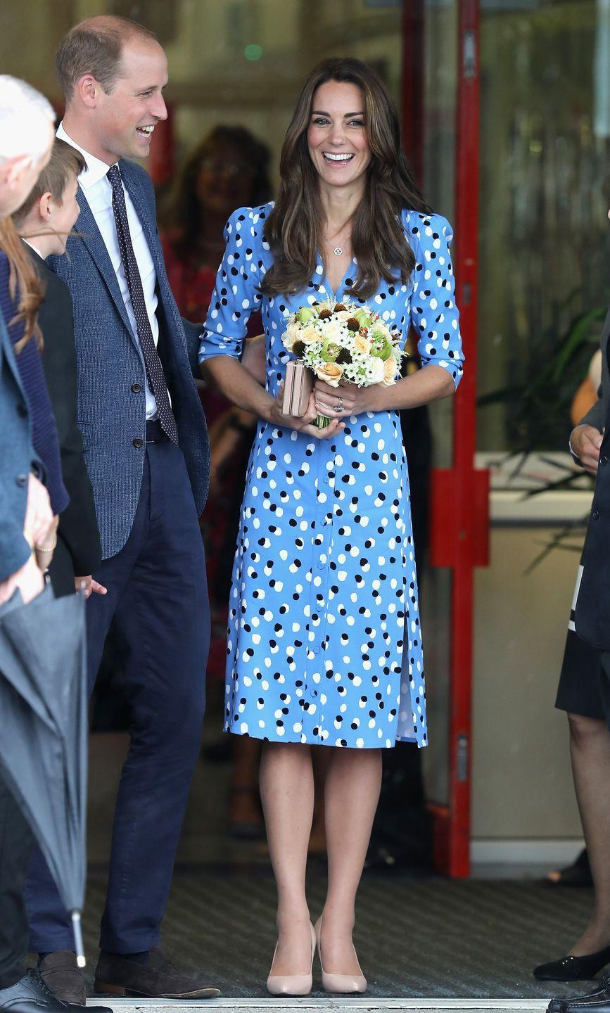 <p>The Duchess wears a printed blue Altuzarra dress and nude pumps while in<br><br><br><br><br><br><br><br><br><br><br><br><br><br><br><br><br><br><br><br><br><br><br><br><br><br><br>Stewards Academy in Harlow, Essex with Prince William.</p>