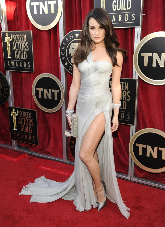 Lea Michele vamped it up in silver, high-slit Atelier Versace gown at the 18th Annual Screen Actors Guild Awards at The Shrine Auditorium on January 29, 2012 in Los Angeles, California. She finished off her look with Lorraine Schwartz gems and metallic Casadei stilettos.