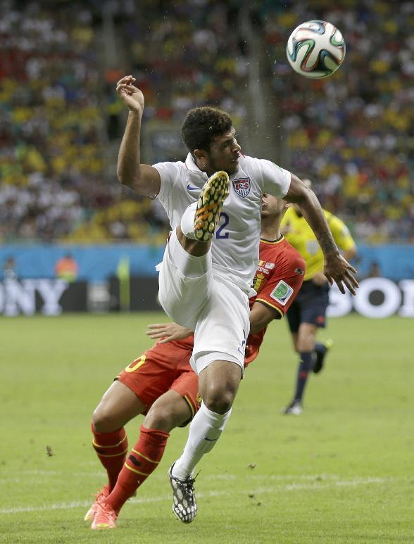 United States' DeAndre Yedlin clears the ball in front of Belgium's Eden Hazard during the World Cup round of 16 soccer match between Belgium and the USA at the Arena Fonte Nova in Salvador, Brazil, Tuesday, July 1, 2014. (AP Photo/Natacha Pisarenko)