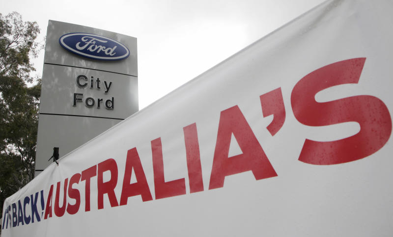 A banner is displayed at a Ford dealership in Sydney on Thursday, May 23, 2013. Ford Motor Co. said it was closing its two Australian auto plants and ending production in the country in 2016, amid soaring manufacturing costs and plummeting sales. (AP Photo/Rick Rycroft)
