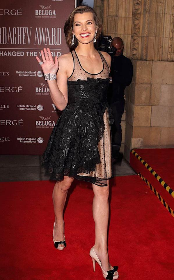 "Another beauty dressed in black this week was ""Fifth Element"" femme fatale Milla Jovovich, who arrived at London's Gorby 80 Gala in a daring Valentino dress and bow-adorned peep-toes. Mike Marsland/<a href=""http://www.wireimage.com"" target=""new"">WireImage.com</a> - March 30, 2011"