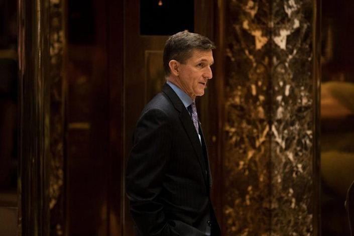 Flynn waits for an elevator in the lobby at Trump Tower on Monday. (Drew Angerer/Getty Images)