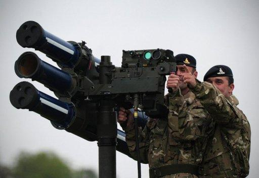 Soldiers demonstrate air defences to be used during the Olympics