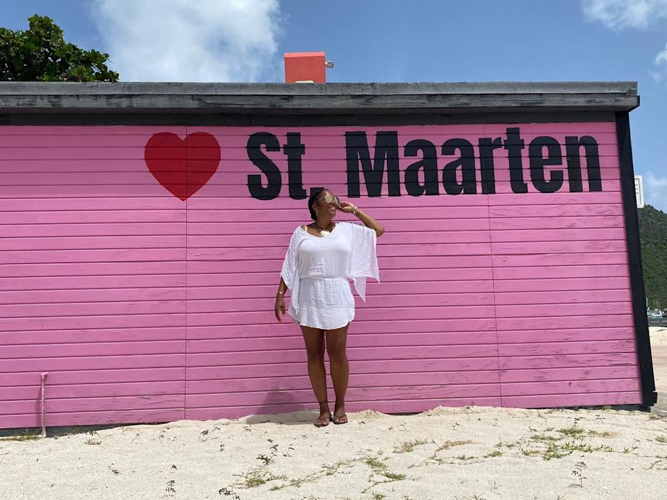 Pink mural on the beach that says St. Maarten.