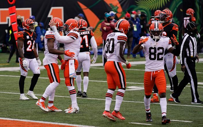 Cleveland Browns quarterback Baker Mayfield (6) talks with wide receiver Donovan Peoples-Jones after Peoples-Jones' touchdown reception during the second half of an NFL football game against the Cincinnati Bengals, Sunday, Oct. 25, 2020, in Cincinnati. - AP