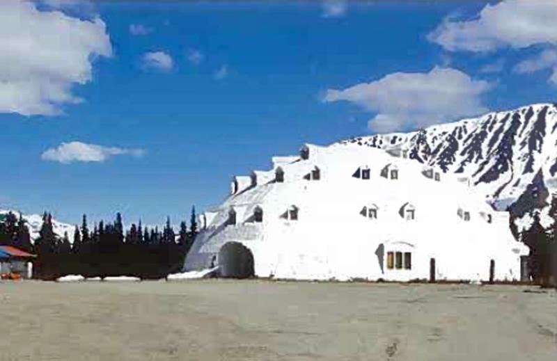 This undated photo provided by Brad Fisher, shows an urethane igloo in Anchorage, Alaska. The igloo, an embodiment of an Alaska cliche, and a must-stop for tourists heading for Denali National Park and Preserve, is for sale. The 80-foot high structure, erected more than four decades and never completed, sits on a 38-acre site, which is part of the sales package. (AP Photo/Brad Fisher)