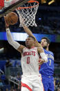 Houston Rockets' Russell Westbrook (0) goes to the basket past Orlando Magic's Michael Carter-Williams (7) during the first half of an NBA basketball game, Friday, Dec. 13, 2019, in Orlando, Fla. (AP Photo/John Raoux)