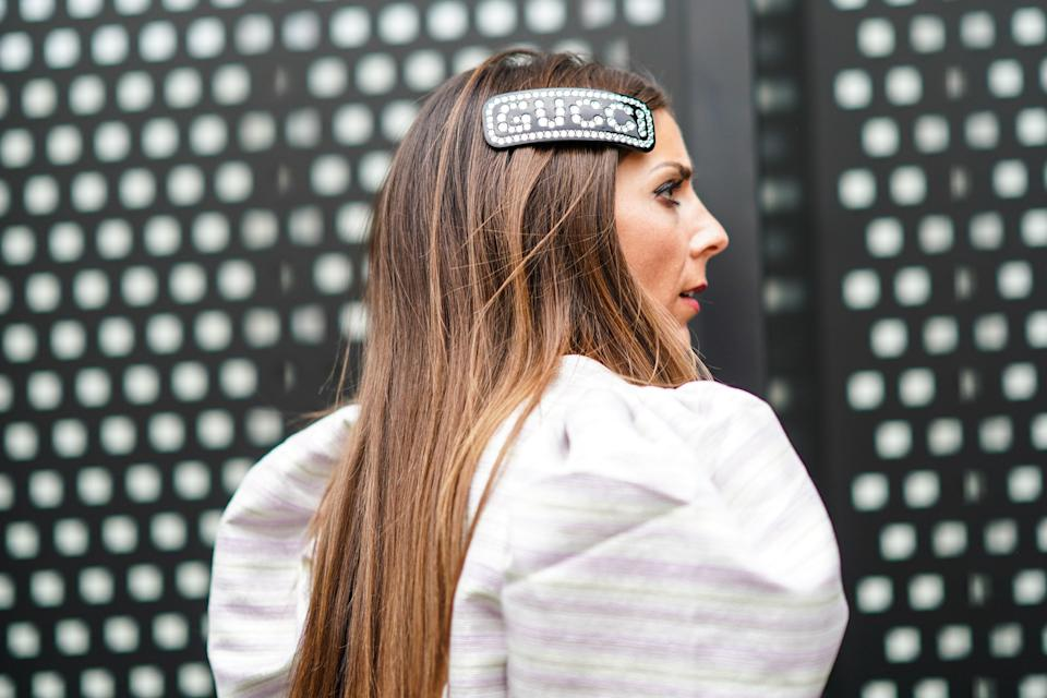"Hair clips are certainly having a moment this season, and <a href=""https://www.ssense.com/en-us/women/product/gucci/tortoiseshell-crystal-logo-barrette/4389691?gclid=EAIaIQobChMItafe5Ibw5AIVmonICh1YoQcVEAQYAiABEgKj2fD_BwE"" rel=""nofollow noopener"" target=""_blank"" data-ylk=""slk:this super luxe one"" class=""link rapid-noclick-resp"">this super luxe one</a> can't be beat."