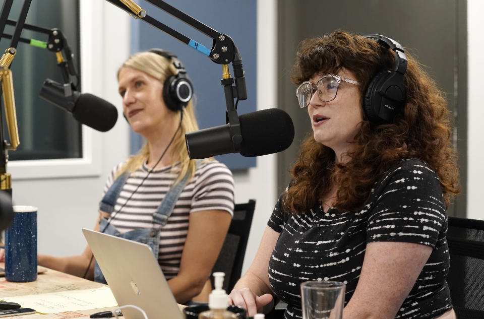 """Tess Barker, left, and Barbara Gray, co-hosts of the """"Britney's Gram"""" podcast, talk at Earwolf podcast studio, Thursday, July 15, 2021, in Los Angeles. (AP Photo/Chris Pizzello)"""