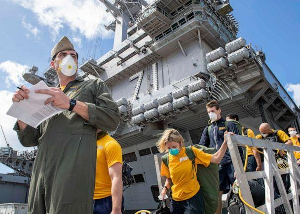 PHOTO: Sailors assigned to the aircraft carrier USS Theodore Roosevelt (CVN 71) depart the ship to move to off-ship berthing, April 10, 2020. (U.S. Navy)