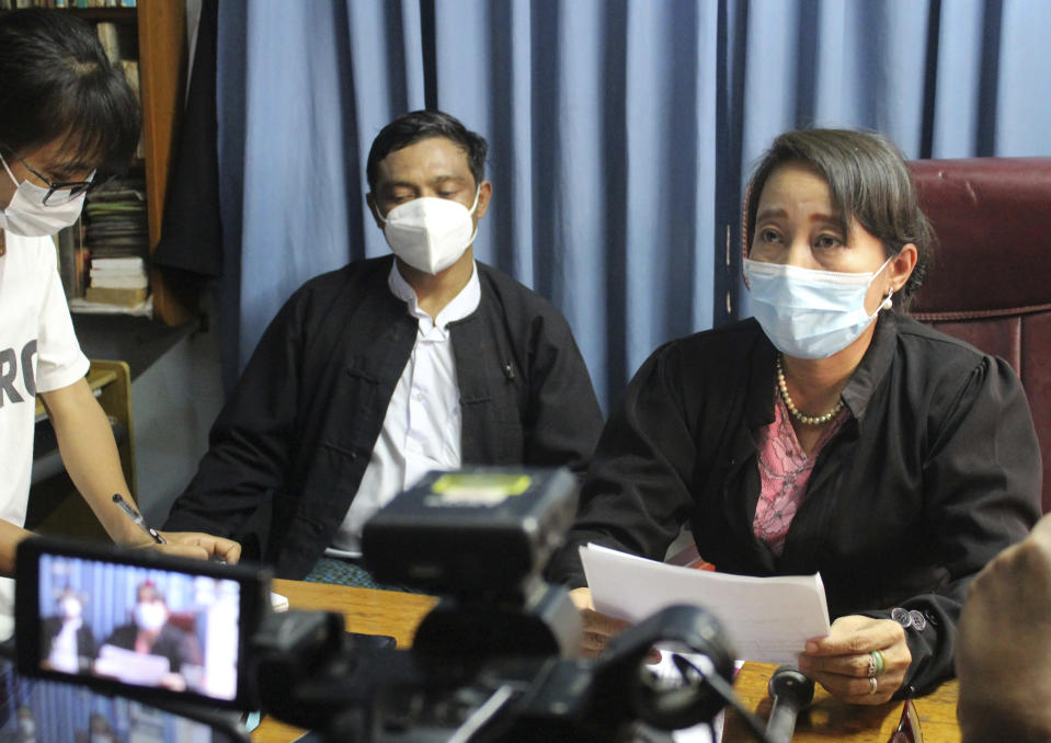 Min Min Soe, right, and Thae Maung Maung, left rear, both lawyers assigned by the National League for Democracy party to represent deposed Myanmar leader Aung San Suu Kyi, meet journalists in Naypyitaw, Myanmar, Monday, June 21, 2021. As the trial of ousted leader Aung San Suu Kyi entered its second week, her lawyers said prosecution witnesses testified about charges that she had illegally imported and used walkie-talkies for her bodyguards, and along with Win Myint, president in her government, had flouted laws on public gatherings that were meant to combat the spread of COVID-19. (AP Photo)