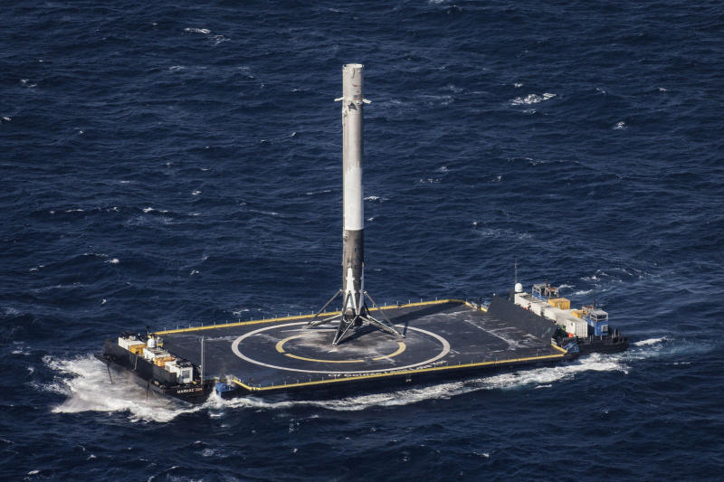 A SpaceX rocket sitting on a platform in the occean