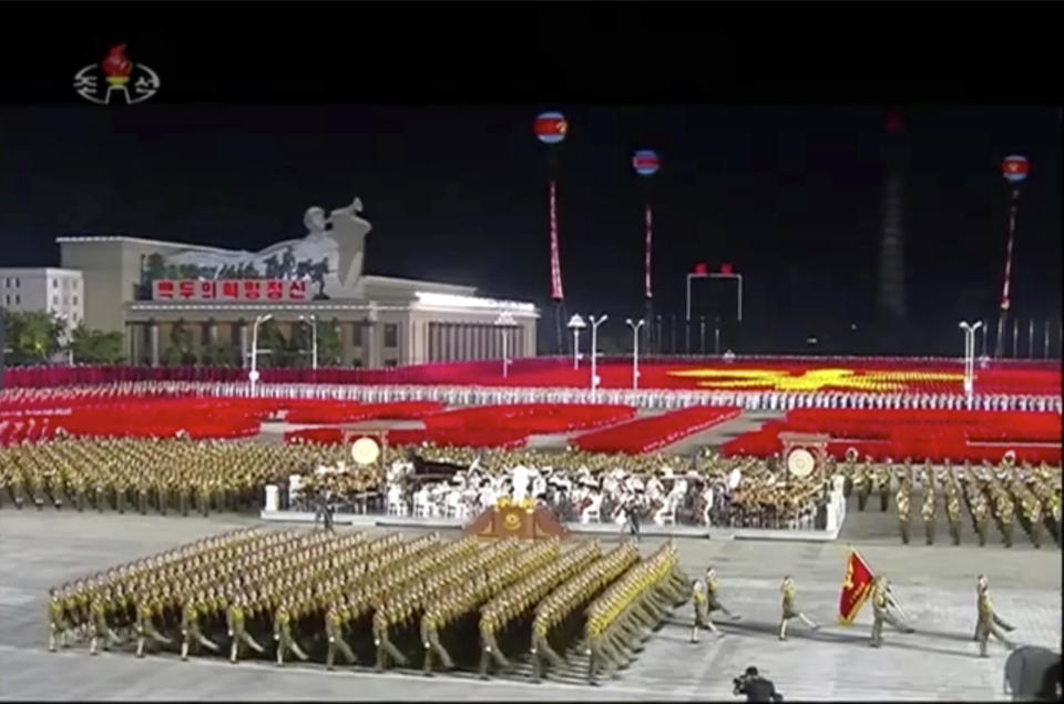 In this image made from video broadcasted by North Korea's KRT on Saturday, Oct. 10, 2020, military parade is held during a ceremony to celebrate the 75th anniversary of the country's ruling party in Pyongyang.(KRT via AP)