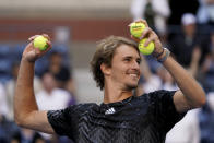 Alexander Zverev, of Germany, throws balls to tennis fans after defeating Albert Ramos-Vinolas, of Spain, during the second round of the US Open tennis championships, Thursday, Sept. 2, 2021, in New York. (AP Photo/Elise Amendola)