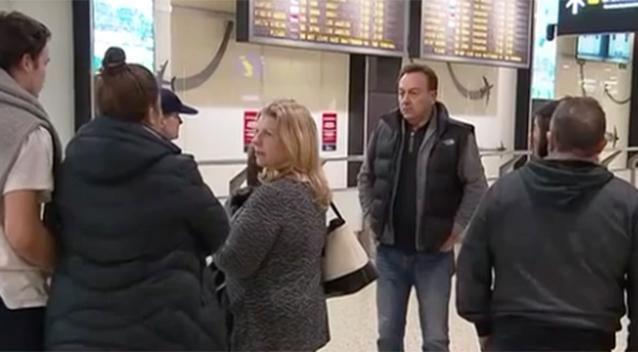 Pictured: Distraught families wait at the airport for information. Photo: 7 News