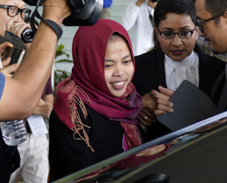 FILE - In this March 11, 2019, file photo, Indonesian Siti Aisyah, center, smiles as she leaves Shah Alam High Court in Shah Alam, Malaysia. The murder of North Korean leader Kim Jong Un's estranged half-brother at an airport in Malaysia was brazen, intricately orchestrated and, thanks to scores of security cameras, witnessed by millions around the world. The real masterminds behind the killing, however, may never be brought to justice. (AP Photo/Yam G-Jun, File)