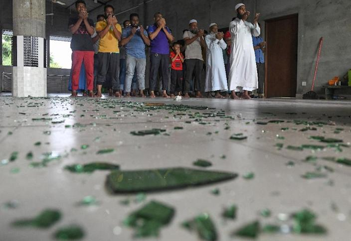 In the town of Minuwangoda, the faithful packed the first floor of the two-storeyed Hujjaj mosque to pray even though repairs were yet to begin (AFP Photo/LAKRUWAN WANNIARACHCHI)