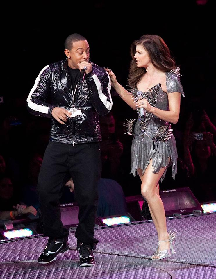 "Back onstage, full-time music man/part-time actor Ludacris joined Fergie in a dress adorned with scary looking spikes. The ""What's Your Fantasy"" singer also warmed up the crowd, along with LMFAO. YN/<a href=""http://www.splashnewsonline.com"" target=""new"">Splash News</a> - February 24, 2010"