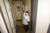 Doris Brown talks about the repairs made from the flood damage to her home Friday, July 31, 2020, in Houston. Brown's home flooded during Harvey and she's part of a group called the Harvey Forgotten Survivors Caucus. (AP Photo/David J. Phillip)