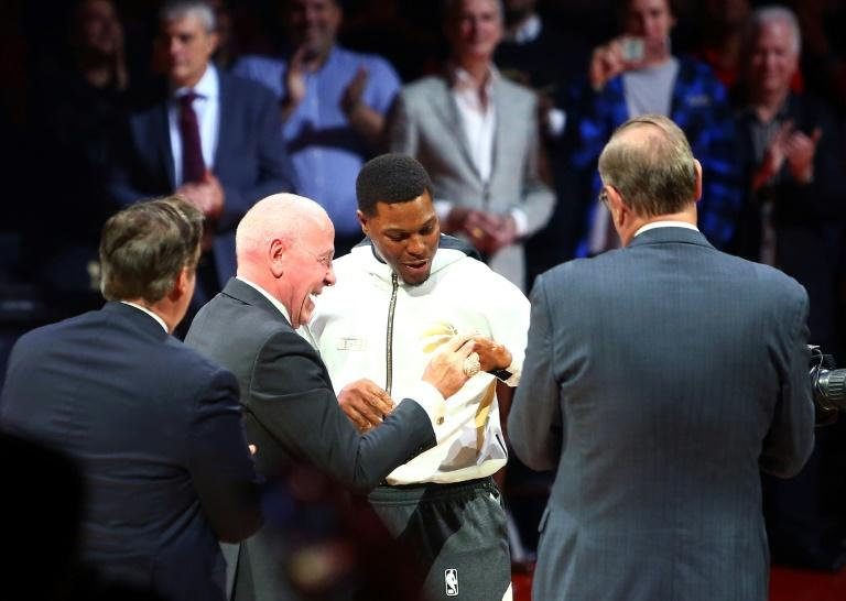 Toronto Raptors Kyle Lowry receives his championship ring from Larry Tanenbaum, chairman of Maple Leaf Sports & Entertainment prior to the tip off of a NBA season opening game against New Orleans Pelicans