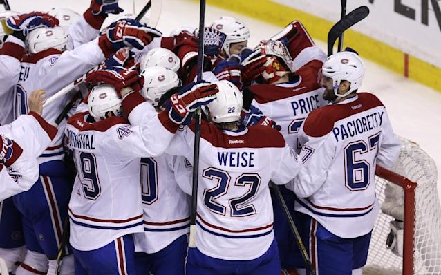 Montreal Canadiens goalie Carey Price is congratulated by teammates after the Canadiens' 3-1 win against the Boston Bruins in Game 7 of a second-round NHL hockey Stanley Cup playoff series in Boston, Wednesday, May 14, 2014. The Canadiens advanced to the Eastern Conference finals against the New York Rangers. (AP Photo)