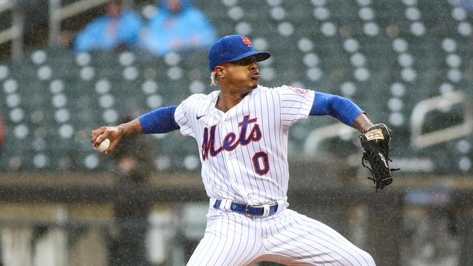 New York Mets pitcher Marcus Stroman (0) pitches in the first inning against the Miami Marlins prior to a rain delay being called at Citi Field.