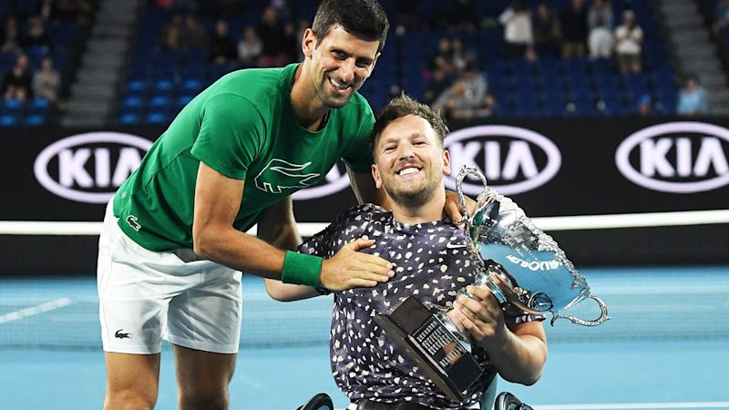 Dylan Alcott, pictured here celebrating his Australian Open triumph with Novak Djokovic.