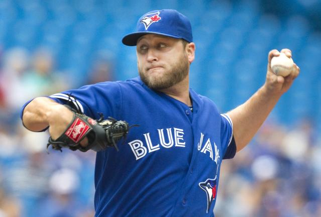 Toronto Blue Jays starting pitcher Mark Buehrle throws against the Tampa Bay Rays during the first inning of a baseball game in Toronto, Saturday, Aug. 23, 2014. (AP Photo/The Canadian Press, Fred Thornhill)