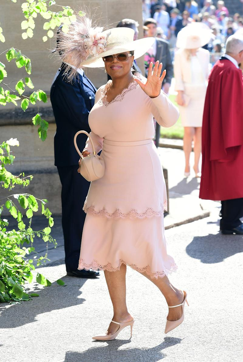 Oprah Winfrey in Stella McCartney arrives at St George's Chapel at Windsor Castle before the wedding of Prince Harry to Meghan Markle on May 19, 2018 in Windsor, England.