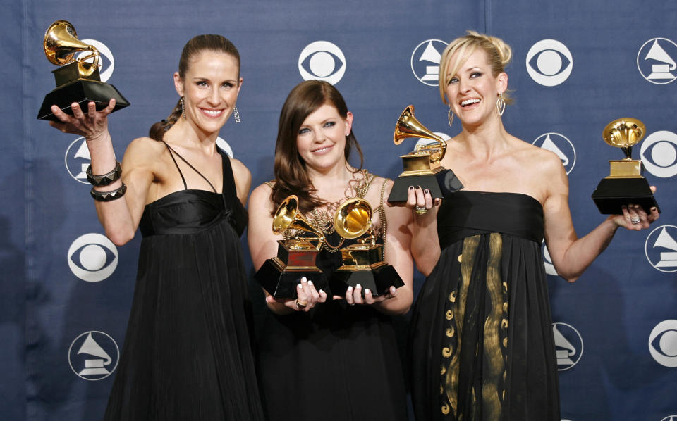 """The Dixie Chicks (L-R) Emily Robison, Natalie Maines and Martie Maguire pose with their Grammys at the 49th Annual Grammy Awards in Los Angeles February 11, 2007. The group won the Record of The Year, Song of the Year and Best Country Performance by a Duo or Group with Vocal for """"Not Ready to Make Nice""""; and Best Country Album and Album of the Year for """"Taking The Long Way"""". REUTERS/Mike Blake (UNITED STATES)"""