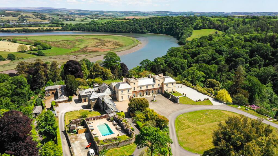 """<p>Reminiscent of a French chateau in parts, Cornwall's <a href=""""https://go.redirectingat.com?id=127X1599956&url=https%3A%2F%2Fwww.booking.com%2Fhotel%2Fgb%2Fpentillie-castle-and-estate.en-gb.html%3Faid%3D2070929%26label%3Dcastle-hotels&sref=https%3A%2F%2Fwww.countryliving.com%2Fuk%2Ftravel-ideas%2Fstaycation-uk%2Fg35418369%2Fcastle-hotels%2F"""" rel=""""nofollow noopener"""" target=""""_blank"""" data-ylk=""""slk:Pentillie Castle"""" class=""""link rapid-noclick-resp"""">Pentillie Castle</a> sits firmly on English shores (or river banks), flanked by a river on one side and beautifully manicured gardens on the other - where the castle hotel's resident labradors can often be found strolling.</p><p>The rooms are each uniquely decorated but all retain a sense of historical accuracy, with antique furniture clad in decadent material<a href=""""https://www.redescapes.com/offers/cornwall-saltash-pentillie-castle-hotel"""" rel=""""nofollow noopener"""" target=""""_blank"""" data-ylk=""""slk:"""" class=""""link rapid-noclick-resp""""><br></a></p><p><a href=""""https://www.redescapes.com/offers/cornwall-saltash-pentillie-castle-hotel"""" rel=""""nofollow noopener"""" target=""""_blank"""" data-ylk=""""slk:Read our review of Pentillie Castle"""" class=""""link rapid-noclick-resp"""">Read our review of Pentillie Castle</a></p><p><a class=""""link rapid-noclick-resp"""" href=""""https://go.redirectingat.com?id=127X1599956&url=https%3A%2F%2Fwww.booking.com%2Fhotel%2Fgb%2Fpentillie-castle-and-estate.en-gb.html%3Faid%3D2070929%26label%3Dcastle-hotels&sref=https%3A%2F%2Fwww.countryliving.com%2Fuk%2Ftravel-ideas%2Fstaycation-uk%2Fg35418369%2Fcastle-hotels%2F"""" rel=""""nofollow noopener"""" target=""""_blank"""" data-ylk=""""slk:CHECK AVAILABILITY"""">CHECK AVAILABILITY</a></p>"""