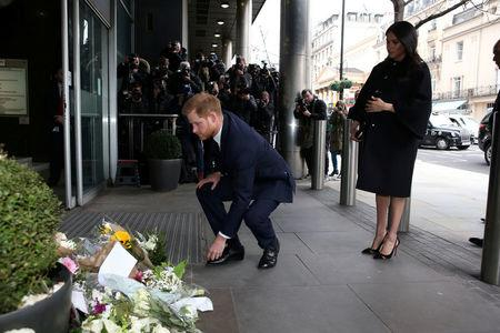 Britain's Prince Harry and Meghan, Duchess of Sussex visit the New Zealand High Commission to sign a book of condolence on behalf of the Royal Family, in London