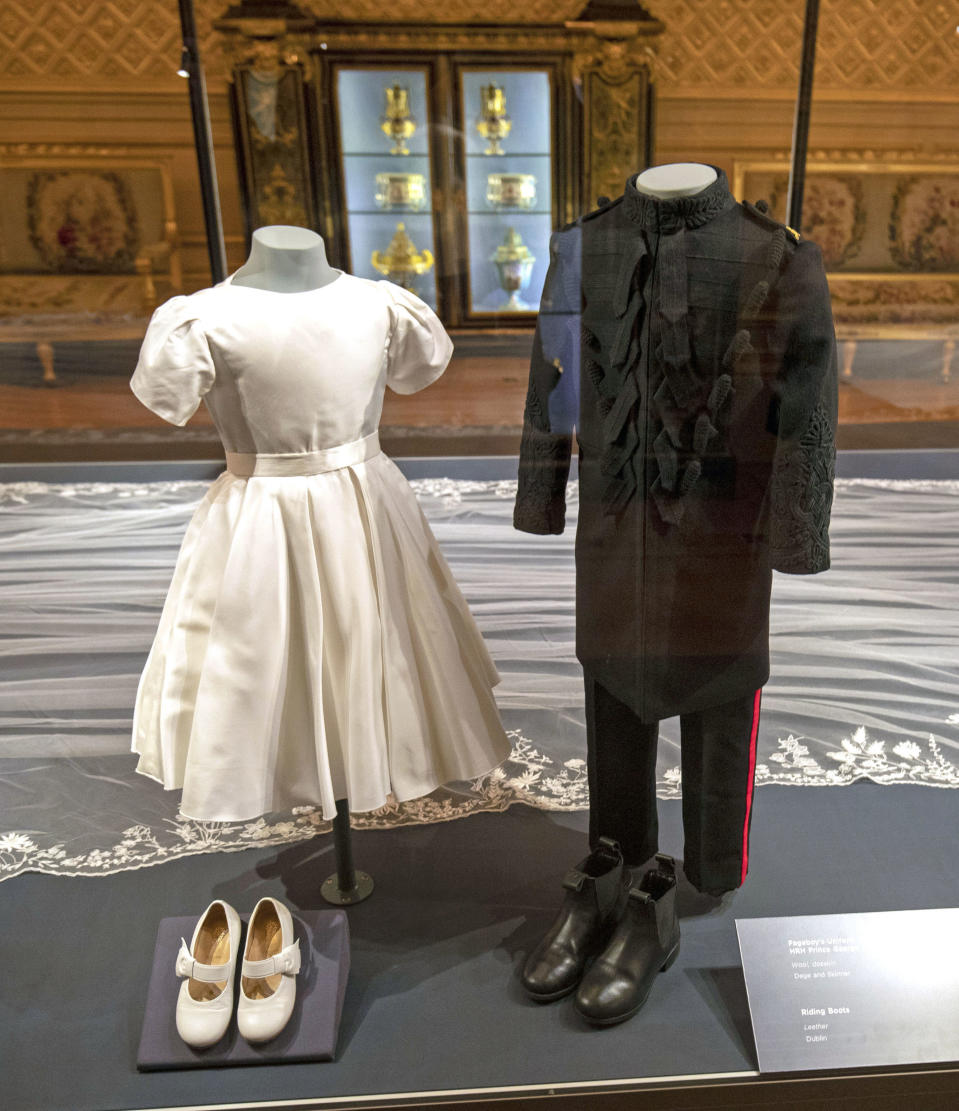 Princess Charlotte and Prince George's royal wedding outfits are on display in the exhibition (PA)