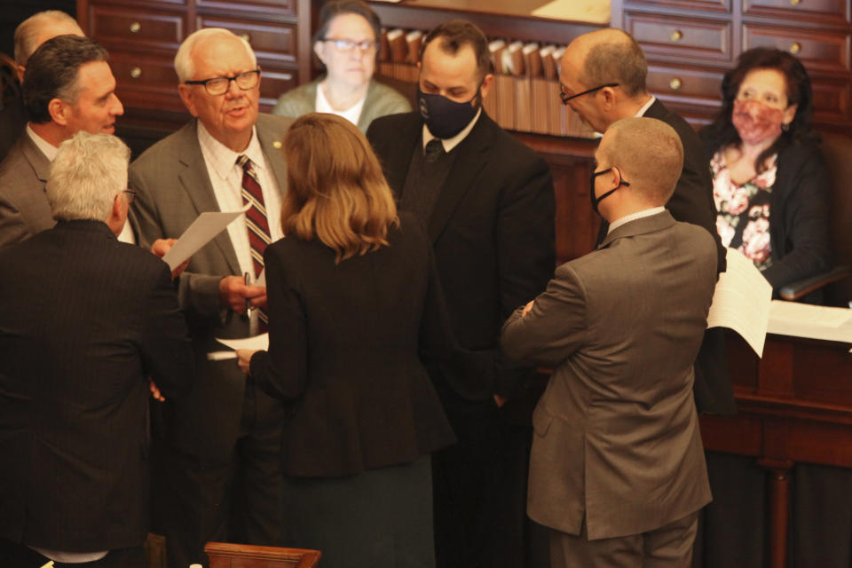 Members of the Kansas Senate's Rules Committee confer during a debate on a bill that would ban transgender students from girls' and women's school sports at the Statehouse, Wednesday, March 17, 2021, in Topeka, Kan. (AP Photo/John Hanna)