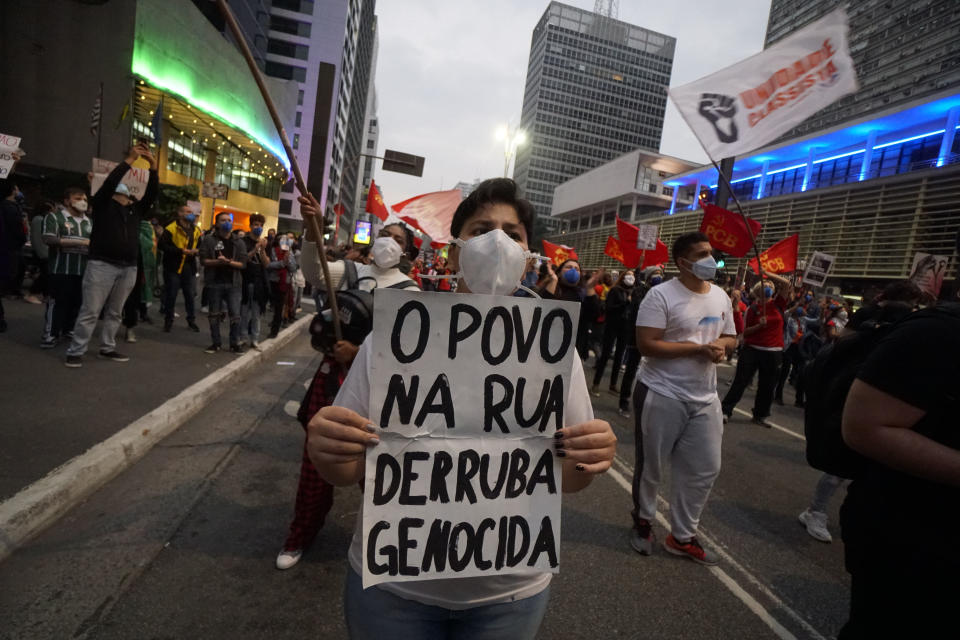Demonstrators gather with signs and flags during a protest against Bolsonaro's administration on June 19, 2021 in Sao Paulo, Brazil. Brazilian president Jair Bolsonaro is facing a probe for pandemic mismanagement as the country counts 500,022 deaths of COVID. The controversial decision to host the Copa America 2021 amid the coronavirus crisis is questioned by a large part of the population. (Photo by Cris Faga/NurPhoto via Getty Images)