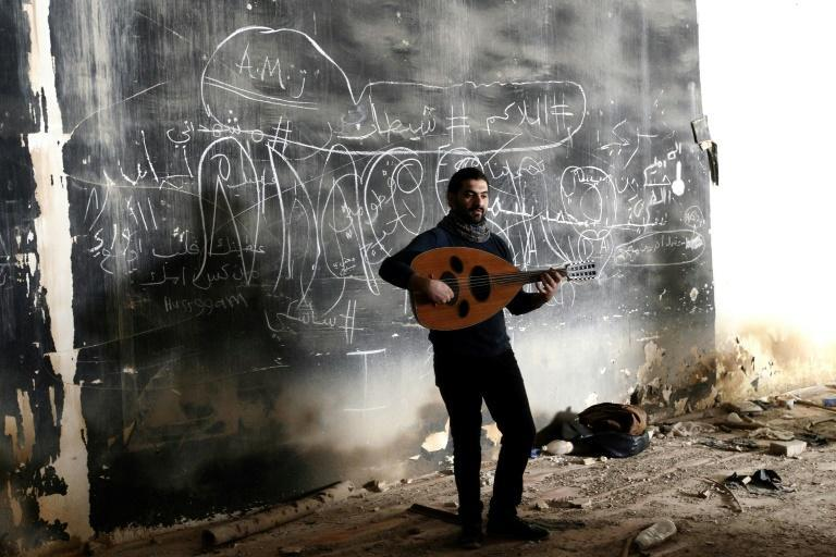 An artist practises at the Abu Nuwas Theatre that was destroyed in 2003 during the war in the Iraqi capital Baghdad on November 17, 2018