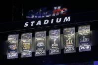 The New England Patriots unveil a sixth banner, right, commemorating the team's Super Bowl 53 victory before an NFL football game against the Pittsburgh Steelers, Sunday, Sept. 8, 2019, in Foxborough, Mass. (AP Photo/Steven Senne)