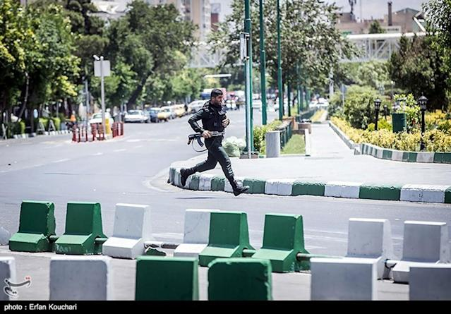 <p>A member of Iranian forces runs during an attack on the Iranian parliament in central Tehran, Iran, June 7, 2017. (Photo: Tasnim News Agency/Handout via Reuters) </p>