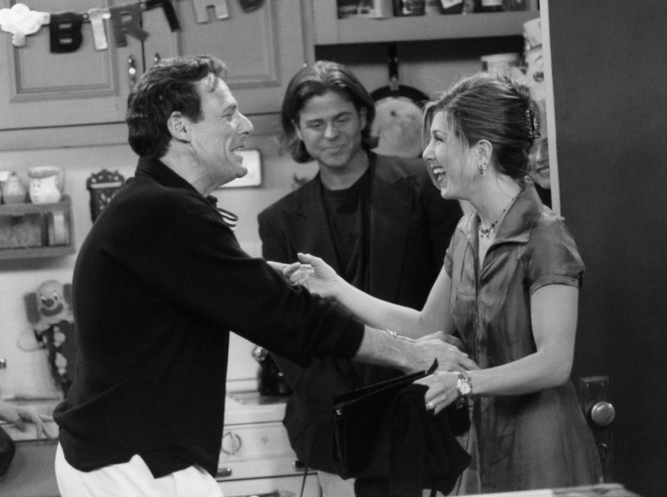 "FRIENDS -- ""The One with the Two Parties"" Episode 22 -- Air Date 05/02/1996 -- Pictured: (l-r) Ron Leibman as Dr. Leonard Green, Jennifer Aniston as Rachel Green  (Photo by NBCU Photo Bank/NBCUniversal via Getty Images via Getty Images)"