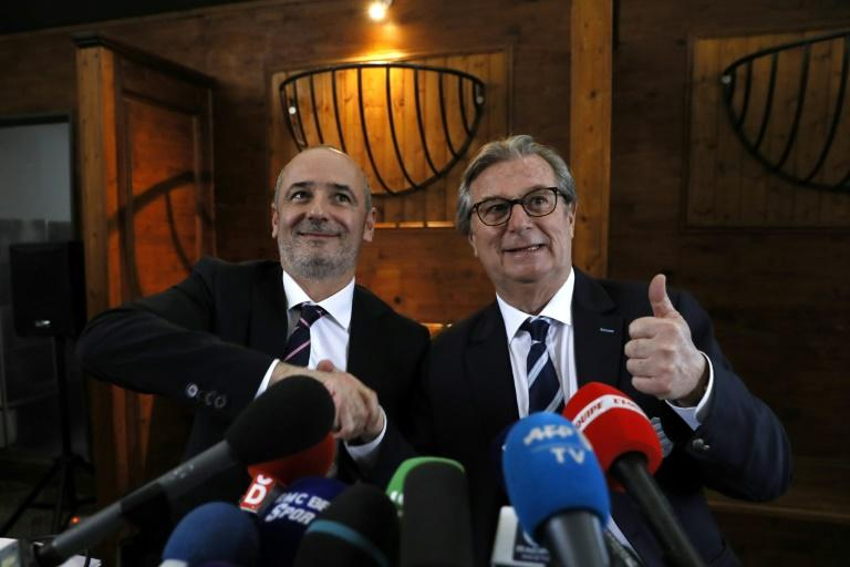 Racing 92 president Jacky Lorenzetti (R) and his Stade Francais counterpart Thomas Savare announced their clubs' planned merger during a press conference in Paris on March 13, 2017
