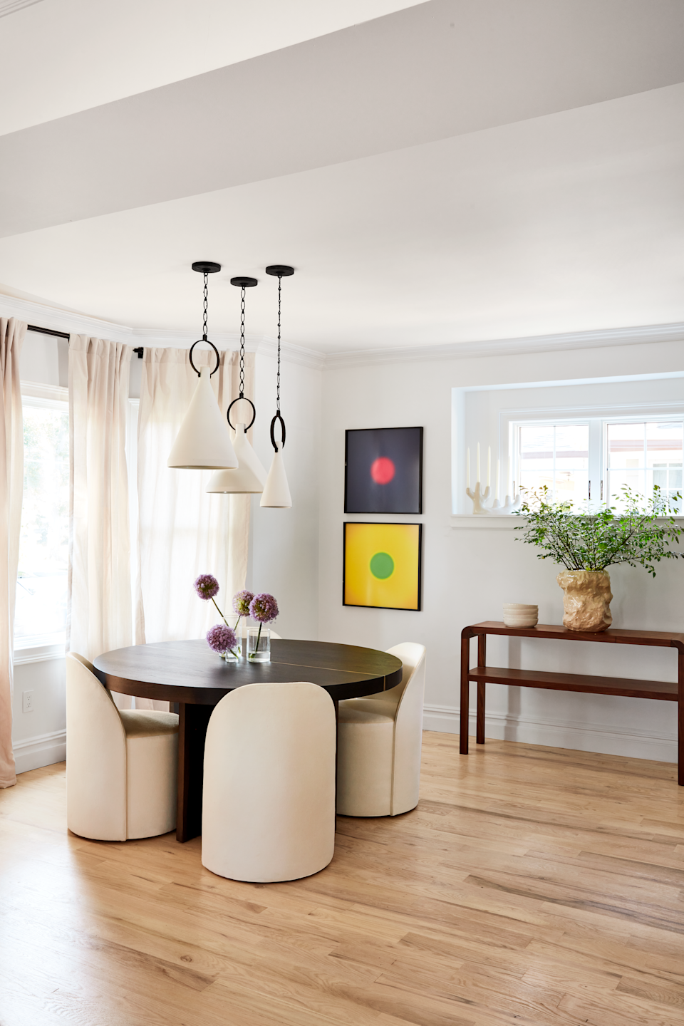 Dining table with pendant lights overhead