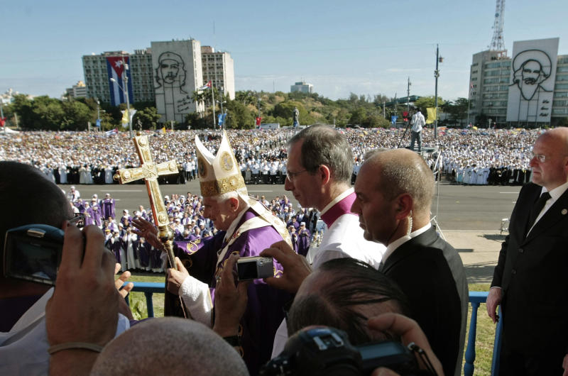 Pope Benedict XVI waves to faithful as arrives to lead a Mass at Revolution Square in Havana, Cuba, Wednesday March 28, 2012.  Pope Benedict XVI wraps up his visit to Cuba on Wednesday with an open-air Mass in the shrine of the Cuban revolution.(AP Photo/Gregorio Borgia)